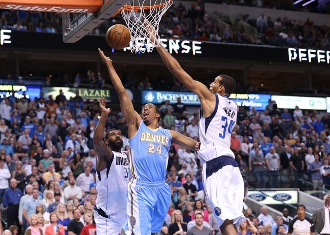 April 12, 2013; Dallas, TX, USA; Denver Nuggets guard Andre Miller (24) shoots against Dallas Mavericks guard O.J. Mayo (32) and forward Brandan Wright (34) at the American Airlines Center. Mandatory Credit: Matthew Emmons-USA TODAY Sports