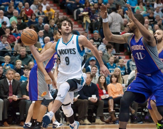 Apr 13, 2013; Minneapolis, MN, USA; Minnesota Timberwolves point guard Ricky Rubio (9) passes the ball as he is defended by Phoenix Suns power forward Markieff Morris (11) in the third quarter at the Target Center. Timberwolves won 105-93. Mandatory Credit:  Greg Smith-USA TODAY Sports