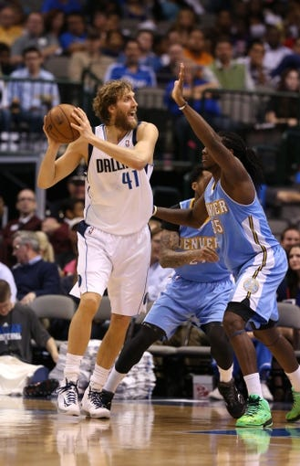 April 12, 2013; Dallas, TX, USA;  Dallas Mavericks forward Dirk Nowitzki (41) in action against the Denver Nuggets at the American Airlines Center. Mandatory Credit: Matthew Emmons-USA TODAY Sports