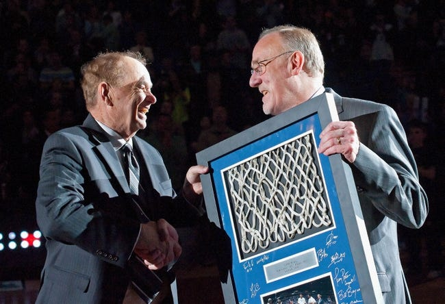 Apr 13, 2013; Minneapolis, MN, USA; Minnesota Timberwolves owner Glen Taylor presents head coach Rick Adelman with a signed plaque honoring Adelman's 1,000 career wins in the NBA before the game against the Phoenix Suns at the Target Center. Timberwolves won 105-93. Mandatory Credit:  Greg Smith-USA TODAY Sports
