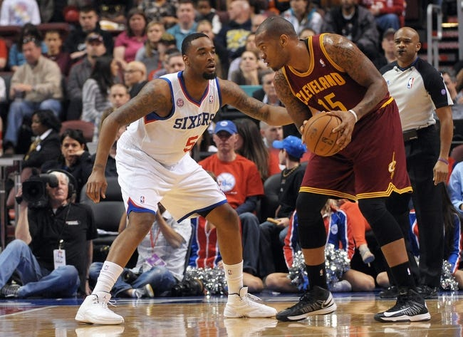Apr 14, 2013; Philadelphia, PA, USA; Cleveland Cavaliers power forward Marreese Speights (15) handles the ball against Philadelphia 76ers power forward Arnett Moultrie (5) during the first quarter at the Wells Fargo Center. Mandatory Credit: Eric Hartline-USA TODAY Sports