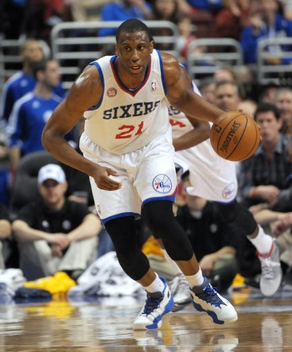 Apr 14, 2013; Philadelphia, PA, USA; Philadelphia 76ers small forward Thaddeus Young (21) brings the ball up court against the Cleveland Cavaliers during the first quarter at the Wells Fargo Center. Mandatory Credit: Eric Hartline-USA TODAY Sports
