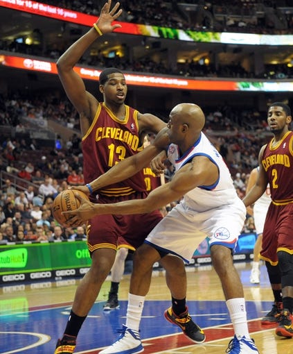 Apr 14, 2013; Philadelphia, PA, USA; Philadelphia 76ers shooting guard Damien Wilkins (8) passes against Cleveland Cavaliers power forward Tristan Thompson (13) during the first quarter at the Wells Fargo Center. Mandatory Credit: Eric Hartline-USA TODAY Sports
