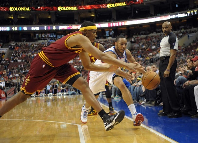 Apr 14, 2013; Philadelphia, PA, USA; Philadelphia 76ers small forward Evan Turner (12) and Cleveland Cavaliers power forward Kevin Jones (5) reach for loose ball during the first quarter at the Wells Fargo Center. Mandatory Credit: Eric Hartline-USA TODAY Sports