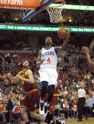 Apr 14, 2013; Philadelphia, PA, USA; Philadelphia 76ers small forward Dorell Wright (4) drives past Cleveland Cavaliers small forward Omri Casspi (36) during the first quarter at the Wells Fargo Center. Mandatory Credit: Eric Hartline-USA TODAY Sports