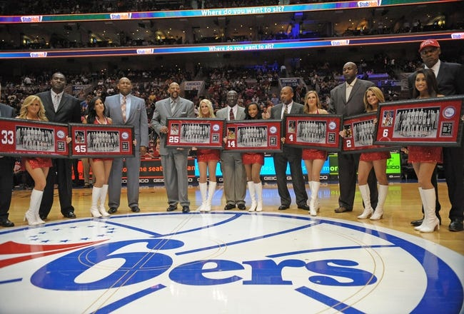 Apr 14, 2013; Philadelphia, PA, USA; Members of the Philadelphia 76ers 1982-83 NBA Championship team, from left: Reggie Johnson (33), Clemon Johnson (45), Earl Cureton (25), Franklin Edwards (14), Clint Richardson (4), Moses Malone (2) and Julius Erving (6) were honored for their 30th anniversary celebration during halftime of the game between Philadelphia 76ers and Cleveland Cavaliers at the Wells Fargo Center. Mandatory Credit: Eric Hartline-USA TODAY Sports
