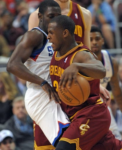 Apr 14, 2013; Philadelphia, PA, USA; Cleveland Cavaliers shooting guard Dion Waiters (3) drives against Philadelphia 76ers point guard Jrue Holiday (11) during the fourth quarter at the Wells Fargo Center. The 76ers defeated the Cavaliers, 91-77. Mandatory Credit: Eric Hartline-USA TODAY Sports