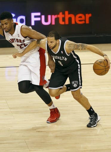 Apr 14, 2013; Toronto, ON, Canada; Brooklyn Nets point guard Deron Williams (8) tries to get past Toronto Raptors forward Rudy Gay (22) at the Air Canada Centre. The Raptors beat the Nets 93-87. Mandatory Credit: Tom Szczerbowski-USA TODAY Sports