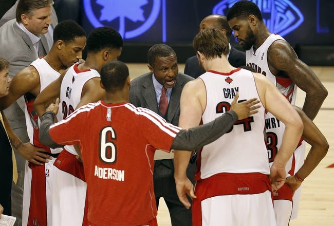 Apr 14, 2013; Toronto, ON, Canada; Toronto Raptors head coach Dwane Casey talks to his players during a timeout against the Brooklyn Nets at the Air Canada Centre. The Raptors beat the Nets 93-87. Mandatory Credit: Tom Szczerbowski-USA TODAY Sports