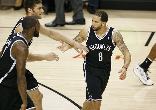 Apr 14, 2013; Toronto, ON, Canada; Brooklyn Nets point guard Deron Williams (8) is congratulated by center Brook Lopez (11) after making a three-pointer against the Toronto Raptors at the Air Canada Centre. The Raptors beat the Nets 93-87. Mandatory Credit: Tom Szczerbowski-USA TODAY Sports