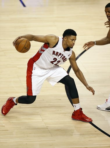 Apr 14, 2013; Toronto, ON, Canada; Toronto Raptors forward Rudy Gay (22) makes a move as he controls the ball against the Brooklyn Nets at the Air Canada Centre. The Raptors beat the Nets 93-87. Mandatory Credit: Tom Szczerbowski-USA TODAY Sports