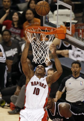 Apr 14, 2013; Toronto, ON, Canada; Toronto Raptors forward DeMar DeRozan (10) goes up to score a basket against the Brooklyn Nets at the Air Canada Centre. The Raptors beat the Nets 93-87. Mandatory Credit: Tom Szczerbowski-USA TODAY Sports