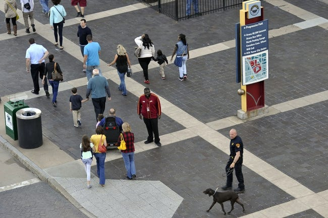 Apr 15, 2013; Cleveland, OH, USA; An arena worker and a Cleveland police officer and his dog stand outside of Quicken Loans Arena before a game between the Cleveland Cavaliers and the Miami Heat. Mandatory Credit: David Richard-USA TODAY Sports