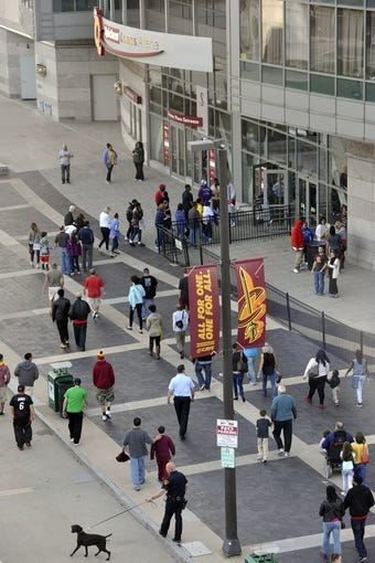 Apr 15, 2013; Cleveland, OH, USA; A Cleveland police officer and his dog walk near an entrance to Quicken Loans Arena before a game between the Cleveland Cavaliers and the Miami Heat. Mandatory Credit: David Richard-USA TODAY Sports