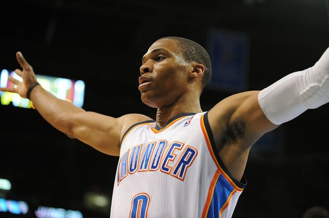 Apr 15, 2013; Oklahoma City, OK, USA; Oklahoma City Thunder guard Russell Westbrook (0) puts up a defensive front against the Sacramento Kings during the first half at Chesapeake Energy Arena. Mandatory Credit: Mark D. Smith-USA TODAY Sports
