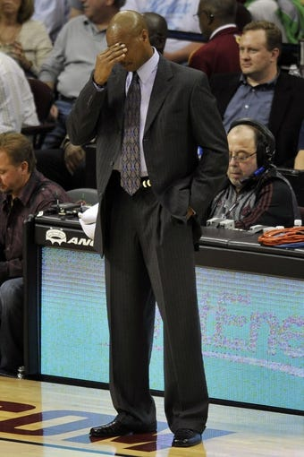 Apr 15, 2013; Cleveland, OH, USA; Cleveland Cavaliers head coach Byron Scott reacts in the fourth quarter against the Miami Heat at Quicken Loans Arena. Mandatory Credit: David Richard-USA TODAY Sports
