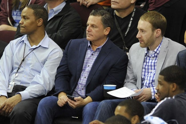 Apr 15, 2013; Cleveland, OH, USA; Cleveland Cavaliers owner Dan Gilbert (center) watches a game against the Miami Heat in the second quarter at Quicken Loans Arena. Mandatory Credit: David Richard-USA TODAY Sports