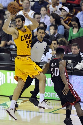 Apr 15, 2013; Cleveland, OH, USA; Cleveland Cavaliers small forward Omri Casspi (36) passes against Miami Heat point guard Norris Cole (30) in the fourth quarter at Quicken Loans Arena. Mandatory Credit: David Richard-USA TODAY Sports