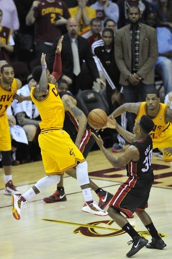 Apr 15, 2013; Cleveland, OH, USA; Miami Heat point guard Norris Cole (30) steals the ball from Cleveland Cavaliers point guard Kyrie Irving (2) in the final seconds of the Heat's 96-95 win at Quicken Loans Arena. Mandatory Credit: David Richard-USA TODAY Sports