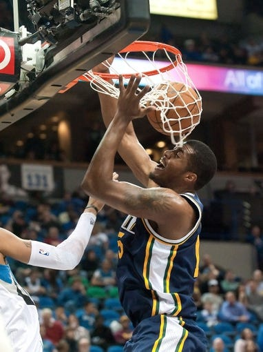 Apr 15, 2013; Minneapolis, MN, USA; Utah Jazz power forward Derrick Favors (15) dunks and Minnesota Timberwolves power forward Chris Johnson (not pictured) defends in the fourth quarter at Target Center. The Jazz won 96-80. Mandatory Credit:  Greg Smith-USA TODAY Sports