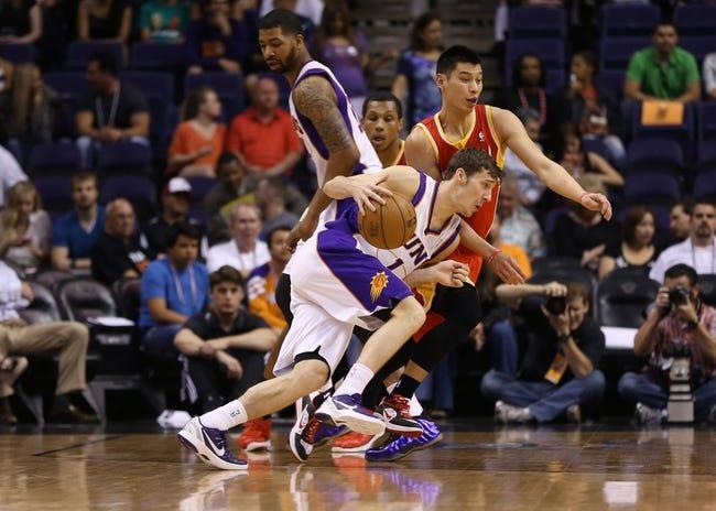 Apr. 15, 2013; Phoenix, AZ, USA: Phoenix Suns guard Goran Dragic (1) drives to the basket against Houston Rockets guard Jeremy Lin in the first quarter at the US Airways Center. Mandatory Credit: Mark J. Rebilas-USA TODAY Sports