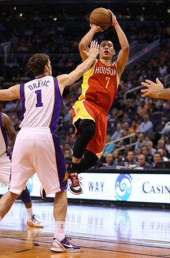 Apr. 15, 2013; Phoenix, AZ, USA: Houston Rockets guard Jeremy Lin (7) takes a shot over Phoenix Suns guard Goran Dragic (1) in the first quarter at the US Airways Center. Mandatory Credit: Mark J. Rebilas-USA TODAY Sports