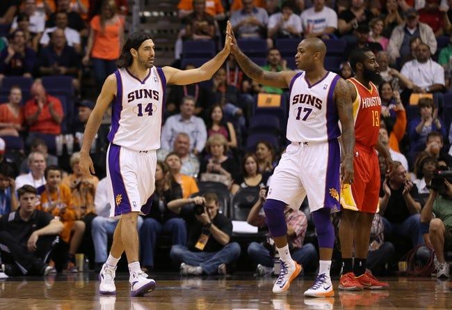 Apr. 15, 2013; Phoenix, AZ, USA: Phoenix Suns forward Luis Scola (14) celebrates with forward P.J. Tucker (17) in the first quarter against the Houston Rockets at the US Airways Center. Mandatory Credit: Mark J. Rebilas-USA TODAY Sports