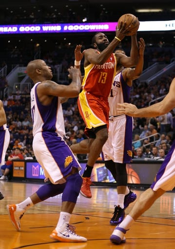 Apr. 15, 2013; Phoenix, AZ, USA: Houston Rockets guard James Harden (13) drives to the basket against the Phoenix Suns in the first quarter at the US Airways Center. Mandatory Credit: Mark J. Rebilas-USA TODAY Sports