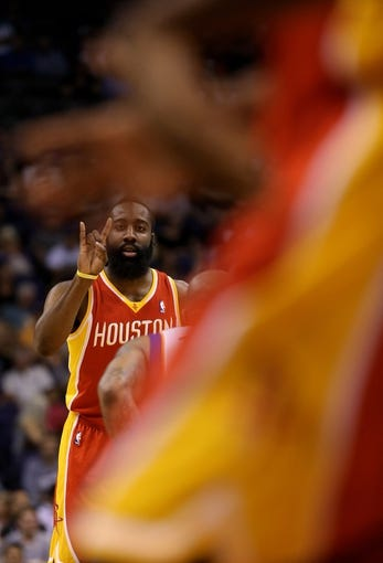 Apr. 15, 2013; Phoenix, AZ, USA: Houston Rockets guard James Harden (13) calls a play against the Phoenix Suns in the first quarter at the US Airways Center. Mandatory Credit: Mark J. Rebilas-USA TODAY Sports