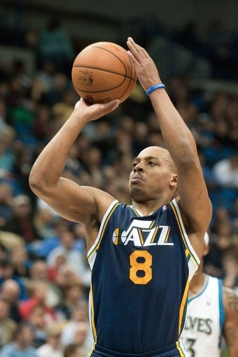 Apr 15, 2013; Minneapolis, MN, USA; Utah Jazz point guard Randy Foye (8) shoots a free throw against the Minnesota Timberwolves in the fourth quarter at Target Center. The Jazz won 96-80. Mandatory Credit:  Greg Smith-USA TODAY Sports