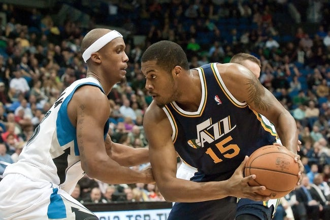 Apr 15, 2013; Minneapolis, MN, USA; Utah Jazz power forward Derrick Favors (15) looks to drive against Minnesota Timberwolves power forward Dante Cunningham (33) in the fourth quarter at Target Center. The Jazz won 96-80. Mandatory Credit:  Greg Smith-USA TODAY Sports