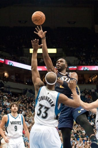 Apr 15, 2013; Minneapolis, MN, USA; Utah Jazz power forward Marvin Williams (2) shoots and Minnesota Timberwolves power forward Dante Cunningham (33) defends in the fourth quarter at Target Center. The Jazz won 96-80. Mandatory Credit:  Greg Smith-USA TODAY Sports