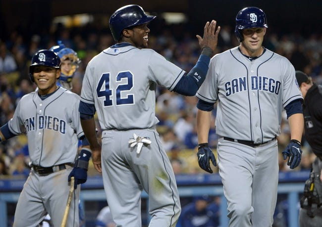 Apr 15, 2013; Los Angeles, CA, USA; San Diego Padres pitcher Eric Stults (right) is congratulated by Alexi Amarista (left) and Cameron Maybin (center) after hitting a three-run home run in the second inning against the Los Angeles Dodgers at Dodger Stadium. Mandatory Credit: Kirby Lee-USA TODAY Sports