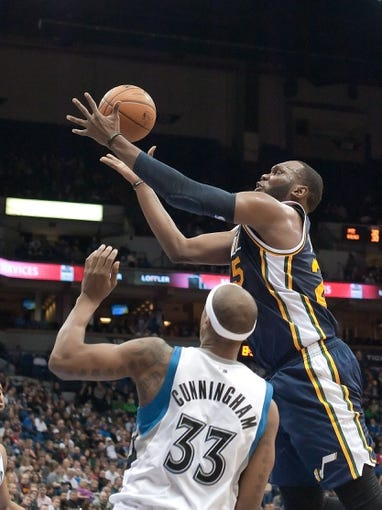 Apr 15, 2013; Minneapolis, MN, USA; Utah Jazz center Al Jefferson (25) and Minnesota Timberwolves power forward Dante Cunningham (33) defends in the fourth quarter at Target Center. The Jazz won 96-80. Mandatory Credit:  Greg Smith-USA TODAY Sports