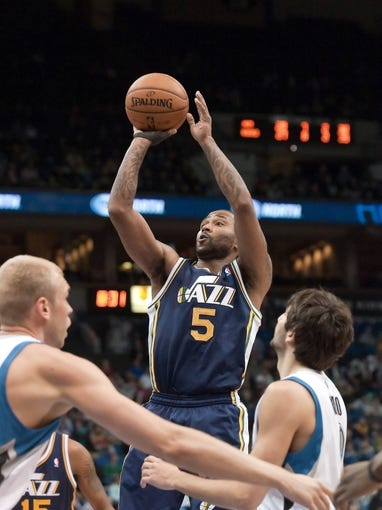 Apr 15, 2013; Minneapolis, MN, USA; Utah Jazz point guard Mo Williams (5) shoots against the Minnesota Timberwolves in the fourth quarter at Target Center. The Jazz won 96-80. Mandatory Credit:  Greg Smith-USA TODAY Sports