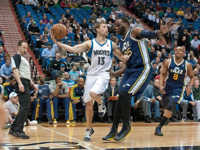 Apr 15, 2013; Minneapolis, MN, USA; Minnesota Timberwolves point guard Luke Ridnour (13) looks to pass and Utah Jazz center Al Jefferson (25) defends in the second quarter at Target Center. The Jazz won 96-80. Mandatory Credit:  Greg Smith-USA TODAY Sports