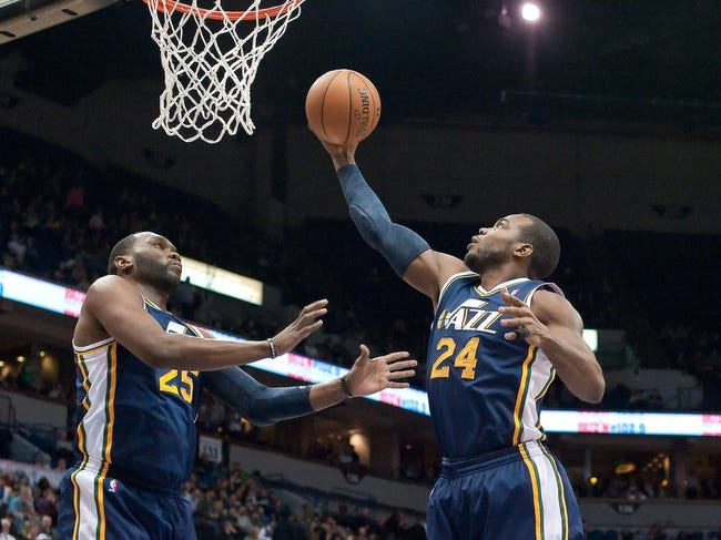 Apr 15, 2013; Minneapolis, MN, USA; Utah Jazz power forward Paul Millsap (24) rebounds in the second quarter against the Minnesota Timberwolves at Target Center. The Jazz won 96-80. Mandatory Credit:  Greg Smith-USA TODAY Sports