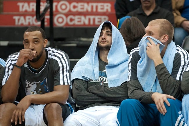 Apr 15, 2013; Minneapolis, MN, USA; (l to r) Minnesota Timberwolves power forward Derrick Williams point guard Ricky Rubio and center Greg Stiemsma watch action from the bench late in the fourth quarter against the Utah Jazz at Target Center. The Jazz won 96-80. Mandatory Credit:  Greg Smith-USA TODAY Sports