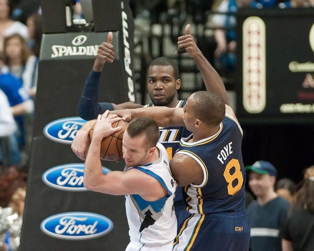 Apr 15, 2013; Minneapolis, MN, USA; Utah Jazz point guard Randy Foye (8) forces a jump ball while defending Minnesota Timberwolves point guard J.J. Barea (11) in the fourth quarter at Target Center. The Jazz won 96-80. Mandatory Credit:  Greg Smith-USA TODAY Sports