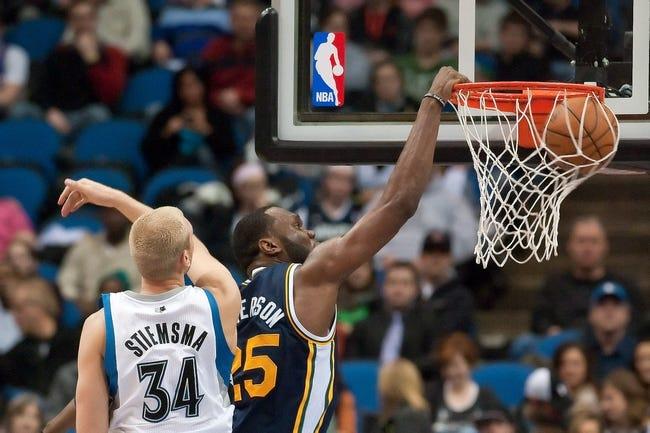 Apr 15, 2013; Minneapolis, MN, USA; Utah Jazz center Al Jefferson (25) dunks the ball and Minnesota Timberwolves center Greg Stiemsma (34) defends in the second quarter at Target Center. The Jazz won 96-80. Mandatory Credit:  Greg Smith-USA TODAY Sports