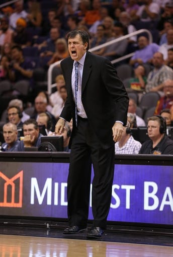 Apr. 15, 2013; Phoenix, AZ, USA: Houston Rockets head coach Kevin McHale reacts in the second half against the Phoenix Suns at the US Airways Center. The Suns defeated the Rockets 119-112. Mandatory Credit: Mark J. Rebilas-USA TODAY Sports