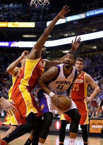 Apr. 15, 2013; Phoenix, AZ, USA: Phoenix Suns forward Markieff Morris (11) drives to the basket in the second half against the Houston Rockets at the US Airways Center. The Suns defeated the Rockets 119-112. Mandatory Credit: Mark J. Rebilas-USA TODAY Sports
