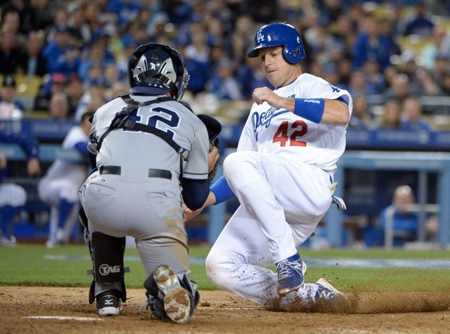Apr 15, 2013; Los Angeles, CA, USA; San Diego Padres catcher John Baker (left) tags out Los Angeles Dodgers catcher A.J. Ellis at home plate in the eighth inning at Dodger Stadium. The Padres defeated the Dodgers 6-3. Mandatory Credit: Kirby Lee-USA TODAY Sports