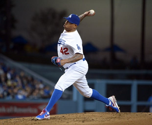 Apr 15, 2013; Los Angeles, CA, USA; Los Angeles Dodgers pitcher Ronald Belisario delivers a pitch against the San Diego Padres at Dodger Stadium. The Padres defeated the Dodgers 6-3. Mandatory Credit: Kirby Lee-USA TODAY Sports
