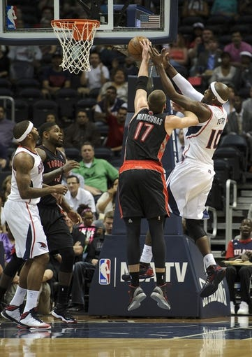 Apr 16, 2013; Atlanta, GA, USA; Toronto Raptors center Jonas Valanciunas (17) and Atlanta Hawks center Johan Petro (10) fight for a rebound during the first half at Philips Arena. Mandatory Credit: Paul Abell-USA TODAY Sports