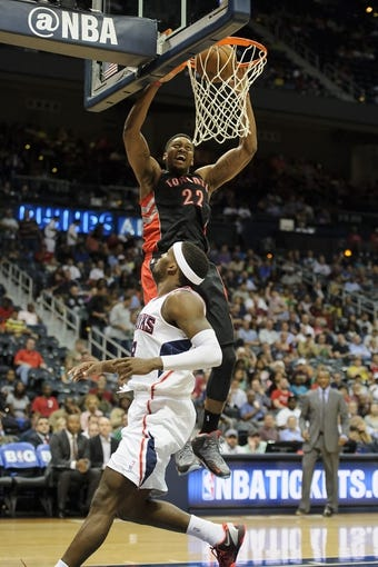 Apr 16, 2013; Atlanta, GA, USA; Toronto Raptors small forward Rudy Gay (22) dunks the ball against Atlanta Hawks point guard Shelvin Mack (8) during the first half at Philips Arena. Mandatory Credit: Paul Abell-USA TODAY Sports