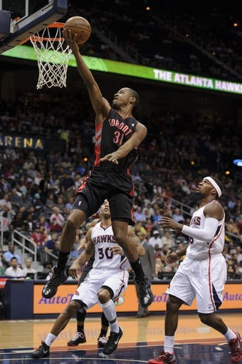 Apr 16, 2013; Atlanta, GA, USA; Toronto Raptors shooting guard Terrence Ross (31) drives to the basket against Atlanta Hawks point guard Shelvin Mack (8) during the first half at Philips Arena. Mandatory Credit: Paul Abell-USA TODAY Sports