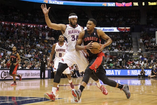Apr 16, 2013; Atlanta, GA, USA; Toronto Raptors small forward Rudy Gay (22) drives past Atlanta Hawks power forward Mike Scott (32) during the first half at Philips Arena. Mandatory Credit: Paul Abell-USA TODAY Sports