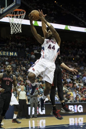 Apr 16, 2013; Atlanta, GA, USA; Atlanta Hawks power forward Ivan Johnson (44) drives to the basket against the Toronto Raptors during the second half at Philips Arena. The Raptors won 113-96. Mandatory Credit: Paul Abell-USA TODAY Sports