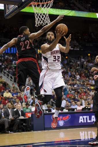 Apr 16, 2013; Atlanta, GA, USA; Atlanta Hawks power forward Mike Scott (32) drives to the basket against Toronto Raptors small forward Rudy Gay (22) during the second half at Philips Arena. The Raptors won 113-96. Mandatory Credit: Paul Abell-USA TODAY Sports